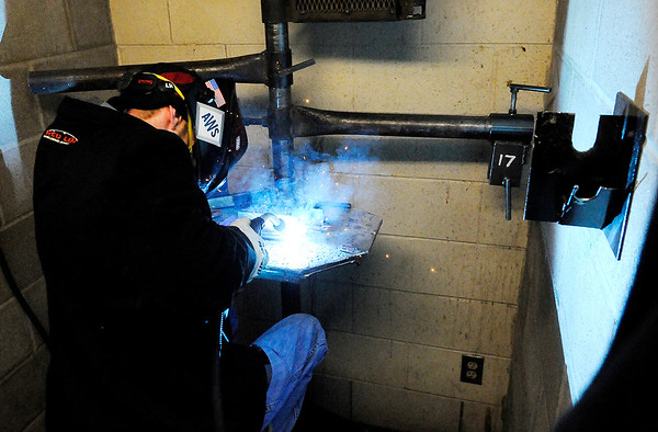 Don Knight   The Herald Bulletin<br /> Lee Rohrer works in one of the welding booths at D26. Welding instructor Robert Richwine has received the local Ivy Tech President's Award.