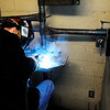 Don Knight | The Herald Bulletin<br /> Lee Rohrer works in one of the welding booths at D26. Welding instructor Robert Richwine has received the local Ivy Tech President's Award.