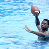 Don Knight | The Herald Bulletin<br /> RJ Nunn throws a football while swimming at Anderson's Southside Pool on Wednesday.