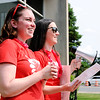 Don Knight | The Herald Bulletin<br /> From left, ACS teachers Ashley Zornes and Janna Ferguson speak to the marchers after arriving at the city building during Anderson's Red for Ed march on Friday. Zornes and Ferguson organized the event to raise awareness about funding for public education.