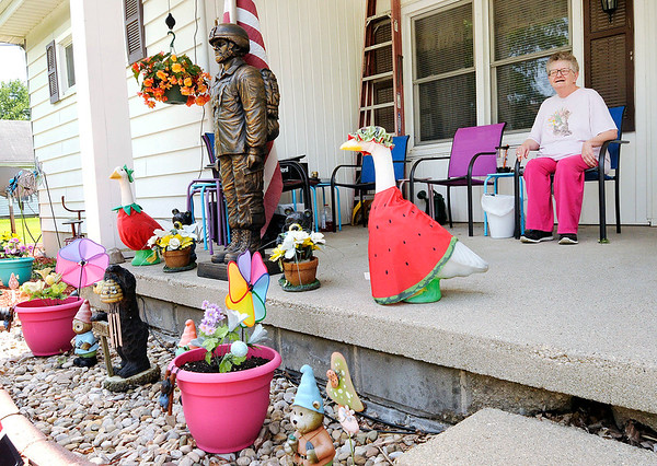 Don Knight | The Herald Bulletin<br /> Linda Anderson sits on the front porch of the home where she lives with her sister and brother-in-law in Alexandria.