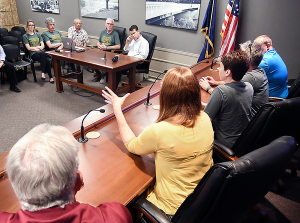 John P. Cleary | The Herald Bulletin<br /> Pendleton town officials discuss with U.S. Senator Todd Young, top center, the effects of being hit by a tornado Memorial Day evening and the after effects on the community during a roundtable discussion Friday afternoon at the town hall.