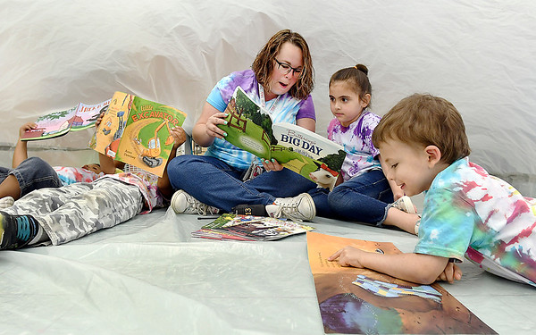John P. Cleary | The Herald Bulletin<br /> Southview Preschool Center paraeducator Jacinda Willoughby reads with her students in their classroom bubble Thursday.