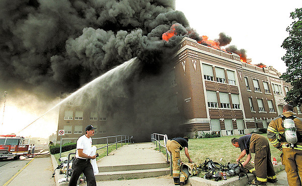 HB photo/John P. Cleary    LN<br /> As Anderson firemen change their air tanks, flames and billowing black smoke rises from the south side of the old Anderson High School building Friday afternoon.