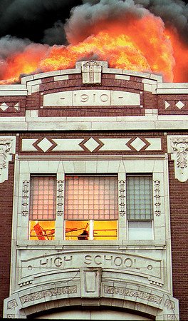 HB photo/John P. Cleary <br /> The front of the old Anderson High School glows in flames Friday afternoon 6/25/99.