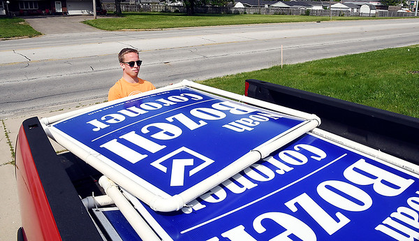 Win or lose the jobs not over the day after an election as Republican candidate for County Coroner Noah Bozell goes around picking up his large campaign signs Wednesday morning. Bozell said he had 75 of these signs around the county to be picked up after being defeated for the office in the primary.