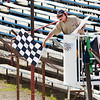 Gary Mong waves the checkered flag on the first heat race of the day as racing returned to Anderson Speedway on Saturday. Read about it in today's Sports section.