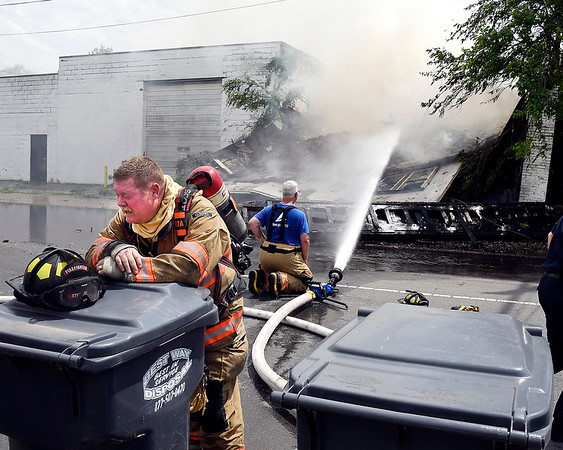 This Pendleton Fire Department firefighter catches his breath after assisting the Anderson Fire Department with mutual aid in battling a fire in the 1600 block of Brown Street in Anderson Wednesday afternoon.