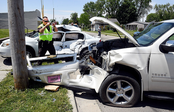 Alexandria Police and the Madison County Sheriff's Department investigate a serious personal injury vehicle accident that involved a roll-over and partial ejection at West Washington and Sheridan Streets in Alexandria Monday afternoon.