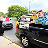 Kim Beard, Daleville Elementary principal, reacts as her students say goodbye Wednesday evening during a drive-thru retirement parade in her honor. Beard is retiring after 33 years as an educator.