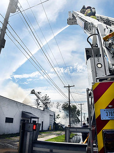 Firefighters used an aerial assault in battling a structure fire in the 1600 block of Brown Street in Anderson.