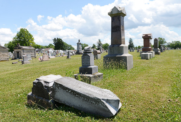A headstone overturned at the Elwood City Cemetery on Thursday. Three children between the age of 5 and 8 were scene smashing ceramic figurines and angels on Tuesday.