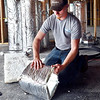 Nardco Heating & Conditioning installer Jon Betz wraps sections of duct work with insulation before installing them in this new home construction in South Anderson this week.