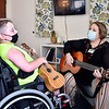 Garret Imel, 10, has a music therapy session with Kirby Gilliam, owner of Plainsong Music Services in their new and larger facilities in the old Anderson Federal Savings building at 100 W. 11th Street in Anderson.