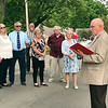 """The descendants of one of the Moravian missionaries listen Tuesday as Madison County Historian Stephen Jackson recounts how they arrived to convert the Delaware Indians to Christianity. """"This road was the main Indian road, so when the missionaries came, they followed the Indian road up to where it turned at the river,"""" he said."""