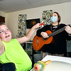 Garret Imel, 10, gets into the rhythm of the music as he plays the bells with Kirby Gilliam during his session with her at Plainsong Music Services recently.