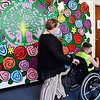 Plainsong Music Services owner Kirby Gilliam pushes Garret Imel, 10, to his session past the large, colorful mural they have in the client waiting room of their new facilities located at 100 W. 11th Street in Anderson.