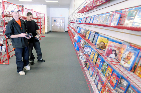 Dustin Imel, left, and Kenneth Mitchell shop the video selection at Dave's Video on Tuesday. Dave's is going out of business after 22 years in Anderson.