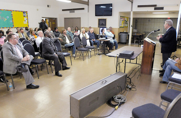 Mayor Kevin Smith gives a presentation during a town hall meeting at the Geater Center on Thursday.