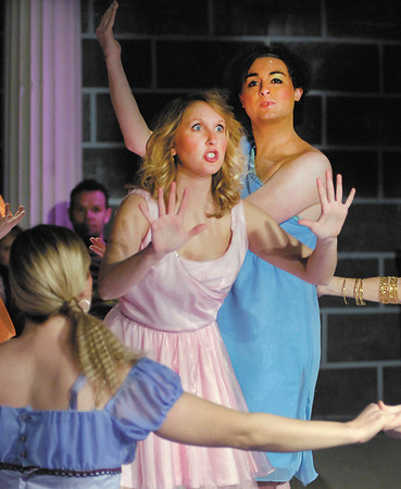 Muse Kira, played by Kayla Shoemaker, sings one of her songs as her sister muses dance around her in the Mainstage production of XANADU.