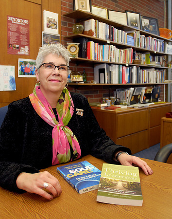 Marie Morris, AU Provost that has contributed to two books.