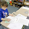Hannah Corzine, 8, writes a fair tale in Brittany Chesnut's third grade class at Anderson Christian School on Wednesday.
