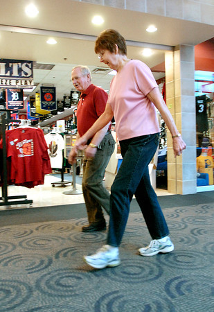 Dave Hexamer and Eunice McKen set a fast pace as they make their laps around the Mounds Mall as the stores are just opening for the day.