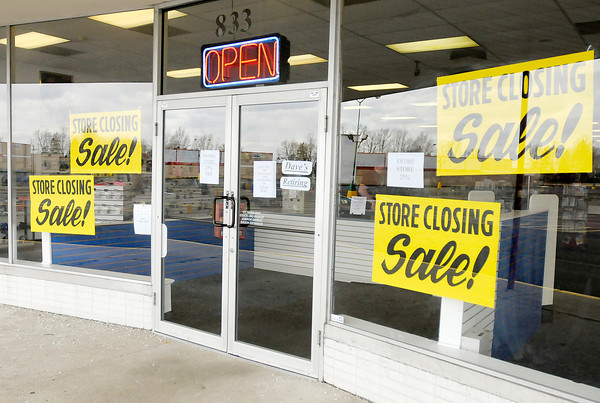 Signs advertise that Dave's Video in Anderson is going out of business after 22 years in Anderson.