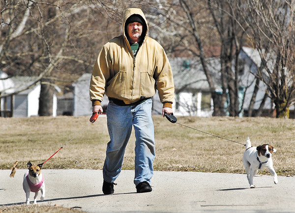 It felt like the last day of winter with cold temperatures and gusty winds but Twink and Scooby-Doo wanted to go for a walk so their master Joe Hopkins bundled up to brave the elements so they could walk around Pulaski Park Tuesday afternoon.