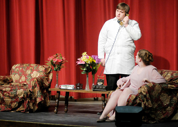 """Zach Myers is Dr. Chumley and Sydney Brobst is Veta Simmons in the Anderson High School production of """"Harvey."""""""