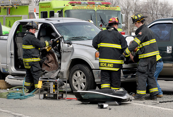 Richland Township fire and rescue personnel cut away the doors of this vehicle to free the driver that was involved in a two-truck personal-injury accident Monday afternoon at SR 9 and north Scatterfield Road.