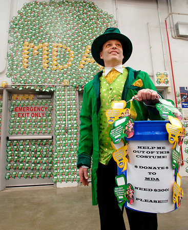 """Mitch Potts, store manager for the Anderson Lowe's, dressed up as a leprechaun Friday to help raise money for Muscular Dystrophy.  Every year Lowe's in Anderson raised money for MD with all the money collected staying in this area to assist local families battling the disease.  Potts goal was to raise $300 and it took the """"leprechaun"""" about 4 hours to reach his goal.  The stores' final goal at the end of the month is to raise $7500."""