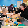 Ryder VanAlst, 1 1/2, gets assistance from mom, Christi VanAlst, as he plays in the large sandbox in the Cardinal Room at the Anderson Public Library.