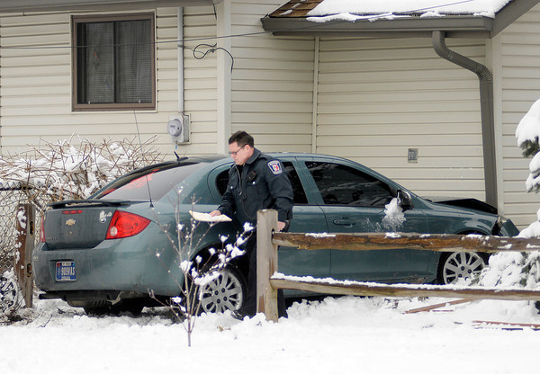 Brooke Hall, 23, of Anderson, was driving on a suspended license when she lost control of her blue-green Chevy Cobalt and struck two homes on Ohio Avenue on Wednesday, said Anderson Police Sgt. Nick Durr.