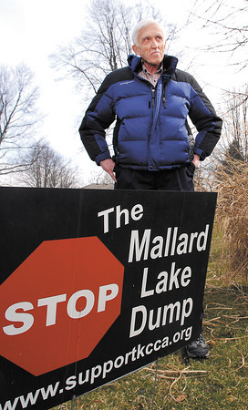 Dr. William Anderson with a Stop The Mallard Lake Dump in his front yard along County Road  East 200N.
