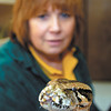 Sarah Roemer of Night Stalkers holds up a Burmese python they have in the store.