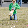 Hannah McBride, 10, picks up Easter eggs during an Easter egg hunt hosted by First Baptist Church on Saturday.