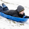 Isaac Finney, 8, sleds down the sledding hill at Shadyside Park during an outing with his family on Thursday. Temperatures are forecast to warm into the 50s this weekend.