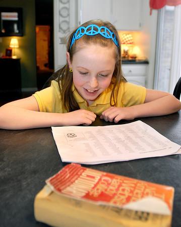 St. Ambrose Elementary School 3rd grader Ellie Fleming studies her list of words as she prepares for The Herald Bulletin Spelling Bee.