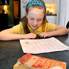 St. Ambrose Elementary School 3rd grader Ellie Fleming studies her list of words as she prepares for The Herald Bulletin Spelling Bee.