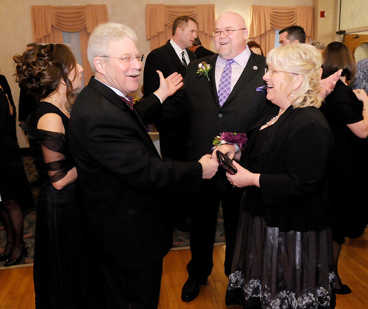 Mayor Kevin Smith and his wife Anita Smith greet Street Commissioner Brad Land and his wife Sharon as they arrive at the Mayor's Ball at the Paramount on Saturday.
