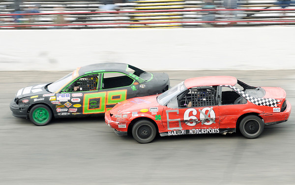 Paul Phipps (66) makes a move inside to pass Nick Warner (09) in the Front Wheel Drive Oval feature race during opening night at Anderson Speedway on Saturday. Phipps went onto win the race.