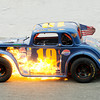 John Robbins' car catches on fire bringing out the caution flag during the Legends 25 lap feature race on opening night at Anderson Speedway on Saturday. Robbins climbed out of the car OK.
