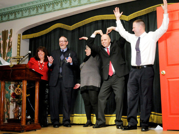 President & CEO of the Chamber of Commerce Kyle Morey, second from right, prompts everyone on the stage to spell out YMCA as the Madison County YMCA was named the Non-Profit of the year for 2012 during the Chamber's 2013 Annual Awards Gala at the Paramount on Thursday. From left are Marcy DeShong, Jack Harter, Nancy Vaughan, Kyle Morey and Jimmy Byrd.