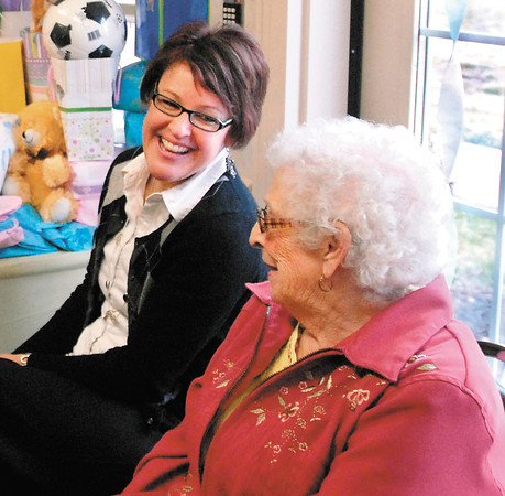 AU nursing professor Sarah Neal has a laugh with Bethany Pointe resident Shirley MacMurray during the baby shower that was given for Neal's nursing students that will be traveling to Uganda to conduct health clinics.