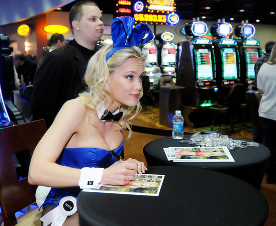 Playboy Playmate Juliette Frette signs autographs at Hoosier Park Racing & Casino on Thursday to help promote the facility's new Playboy Platinum slot machines.