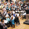 The Madison County Middle Schools Honor Band with guest conductor Michael Sweeney practice at Reardon Auditorium on Saturday. The band will be performing at Reardon on Sunday at 4 p.m.