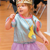 """Princess"" Eliza VanAlst, 4, waves her wand as she plays dress-up during Preschool Promenade at the Anderson Public Library."
