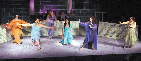 Olympian muses dance around the stage in the Mainstage production of XANADU.