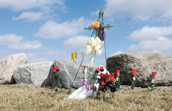 A memorial on County Road 600 West in Delaware County stands near the site of an accident that killed three people on Sunday.